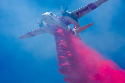 A Cal Fire plane drops fire retardant on a vegetation fire near Bruce Road on Tuesday in Chico. (Matt Bates -- Enterprise-Record)