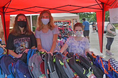 Volunteers from several local houses of worship were on hand to help distribute more than 600 backpacks with school supplies. (Bill Giduz photo)