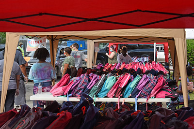 As volunteers coordinated their efforts, hundreds of backpacks were set up to be handed out to local families. The Back2School Backkpack event has been an annual event at Gethsemane Baptist Church in Davidson. With the help of several local churches, volunteers prepared more then 615 backpacks this year. (Bill Giduz photo)