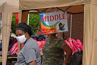 Backpacks were divided into 3 categories - for elementary, middle, and high school aged students. (Bill Giduz photo)