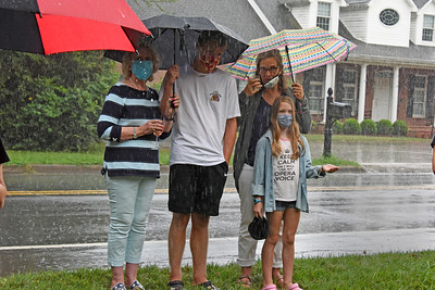 A little rain didn't dampen the spirits of anyone in attendance - like neighbors Autumn Rierson Michael, her, mom, and 2 of her kids. (Bill Giduz photo)