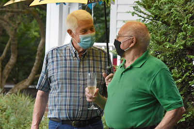 Friends and neighbors stopped by for the party celebrating Betty Walley's 60th anniversary of living in her home on N. Main Street. (Bill Giduz photo)