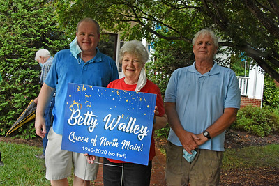 Betty Walley was joined her sons - Scott (l) and Rick (r) to celebrate 60 years of living on N. Main Street. (Bill Giduz photo)