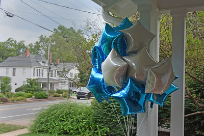 Balloons around the front porch added a festive touch to the celebration. (Bill Giduz photo)