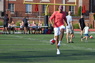 Basketball player Nelson Boachie-Yiadom shows that he has foot ball skills too. He and other scholar-athletes were on hand for FanFest at Richardson Stadium.