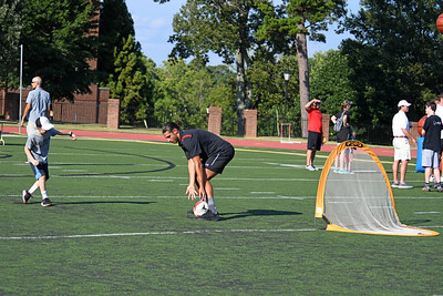 A young player takes a shot on goal against a Wildcat soccer player.