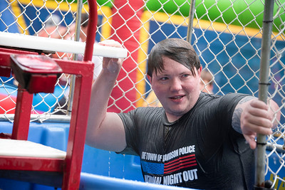 """New Davidson police officer Chris Shelton """"volunteered"""" for the dunk booth at National Night Out. Bill Giduz photo"""