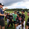 July 28, 2021 - Coach Keith Stuart talks to team members as the Chelmsford 8U state champion youth baseball team practices at Chelmsford High School for the upcoming national tournament in New Jersey.  SUN/Julia Malakie
