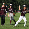 July 28, 2021 - Chelmsford 8U state champion youth baseball team practices at Chelmsford High School for the upcoming national tournament in New Jersey. From left, Elijah Stuart (12), Connor Henry (25), and Anthony Orso (9), during fielding drills. SUN/Julia Malakie