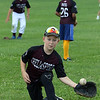 July 28, 2021 - Chelmsford 8U state champion youth baseball team practices at Chelmsford High School for the upcoming national tournament in New Jersey. Elijah Stuart warms up.  SUN/Julia Malakie