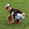 July 28, 2021 - Chelmsford 8U state champion youth baseball team practices at Chelmsford High School for the upcoming national tournament in New Jersey. Trevor Poisson (8) catches a low throw.  SUN/Julia Malakie
