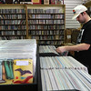 Mike Ciampa of Brookline browses at The Vinyl Vault in Littleton, which sells records including LPs and 45s, as well as cassettes and DVDs.  SUN/Julia Malakie