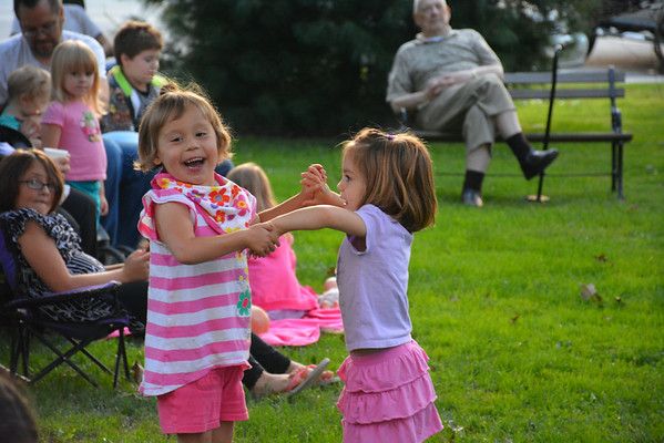 Cousins Adeline Bailey, left, and Brigid Annable dance in front of the courthouse square gazebo Thursday evening.