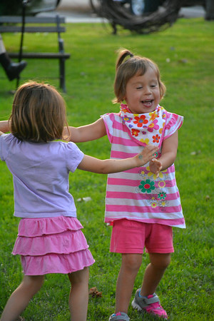 Cousins Brigid Annable and Adeline Bailey dance in front of the courthouse square gazebo Thursday evening.