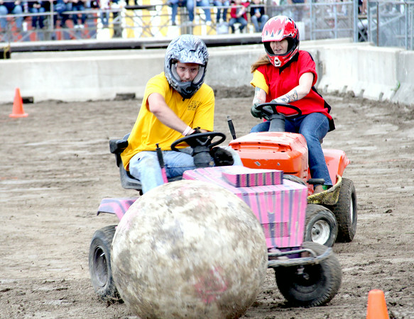 Will Sterling of Edinburg guides a large ball through a set of cones during lawn mower soccer at the Effingham County Fair Saturday night.<br /> Tony Huffman photo