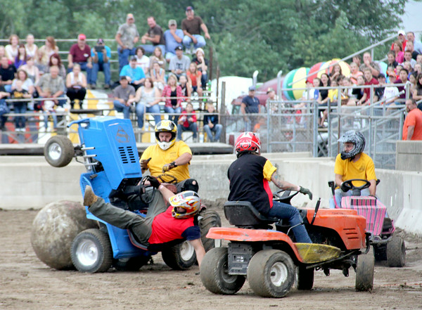 Action during lawn mower soccer kicked into high gear Saturday night at the Effingham County Fair. <br /> Tony Huffman photo