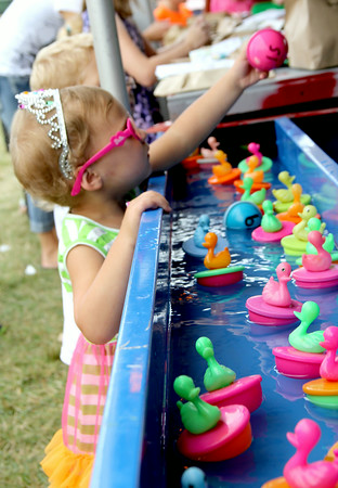 Bella Schultz chooses a duck from the duck pond at St. Anthony Parish Picnic Sunday afternoon. <br /> Tony Huffman photo