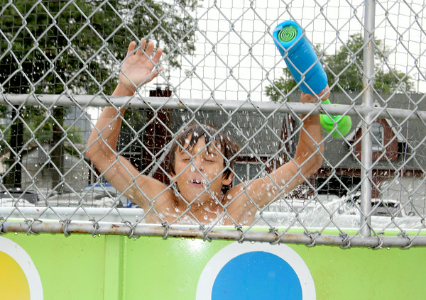 "Zach Wortman falls into the ""Dawg Tank"" at the St. Anthony Parish Picnic Sunday afternoon.<br /> Tony Huffman photo"