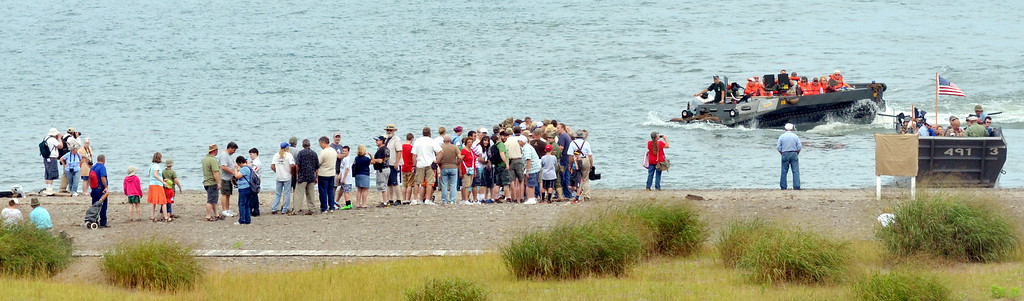 WARREN DILLAWAY / Star Beacon VISITORS TO D-Day Conneaut wait for a landing craft ride on Friday at Conneaut Township Park.