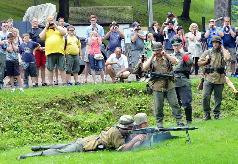 WARREN DILLAWAY / Star Beacon GERMAN RE-ENACTORS give a gun demonstration during Conneaut D-Day activities on Friday at Conneaut Township Park.
