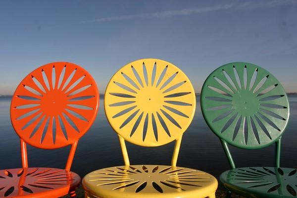 uw university of Wisconsin WI madison student union chairs yellow sunshine sunburst metal lake mendota memorial events rathskeller orange green row terrace
