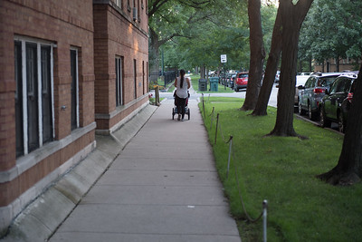 Woman wakling with stroller