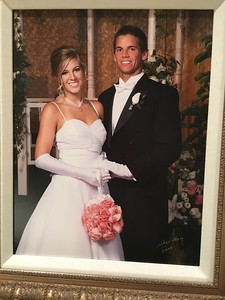 Wedding photos on the wall at home.