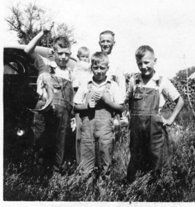Late 1941 or early '42.  L-R front: Tom, Bernard & John.  Back: baby Rose Anne & Earl.