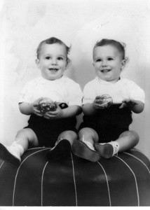 18 months. Bill on left, unless he's on right? We became identical after our Mom kept dressing us that way! :)
