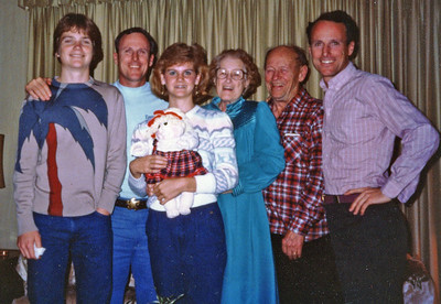 Christmas in Madison, KS (to where the folks had retired in 1976) with Patrick and Roberta - 1984.  Bill on right.