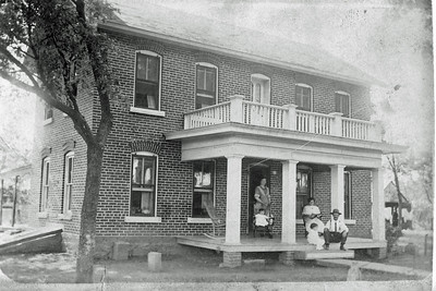 Jamison Family Home in Toronto, Kansas - 1914. Four of six sisters: Victoria in back, Marylou seated in front of her.  Gladys seated on right, Katherine in front of her next to Grandpa Jamie.  [Marylou was one of twelve: six boys and six girls.] Mom was born in this house, Feb. 5, 1912.