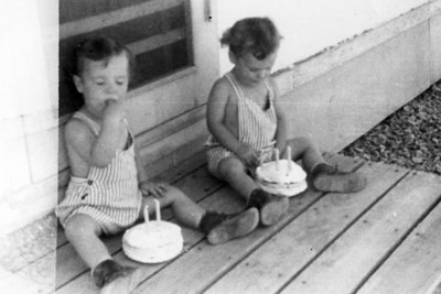 Two years old - 1945 in NM. Our folks knew better than to make one cake to share.  :)
