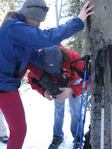 Eric helping with Jessica's YakTrax, for traction on ice.
