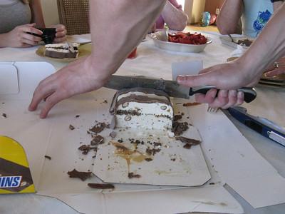 Jason delicately slices the ice cream cake.