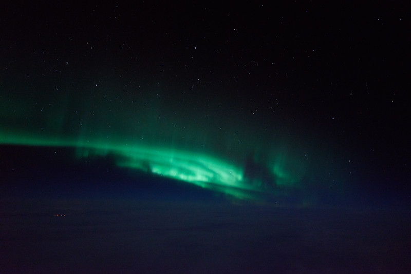 Swirling auroral curtains above the clouds
