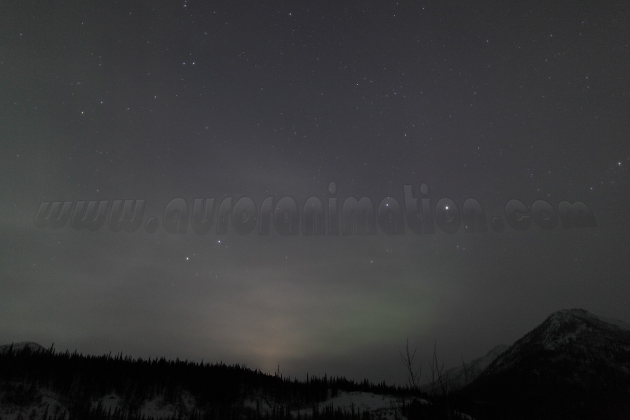 Vernal Equinox: Faint Lunar Halo and Aurora captured at Koyukuk river in Wiseman, Alaska at 04:39 AM on March 20. The Wiseman Village is located within Alaska's Brooks Range at latitude 67.4 and longitude -150.1<br /> <br /> Canon 5D MKII with EF 24mm f/1.4L II lens
