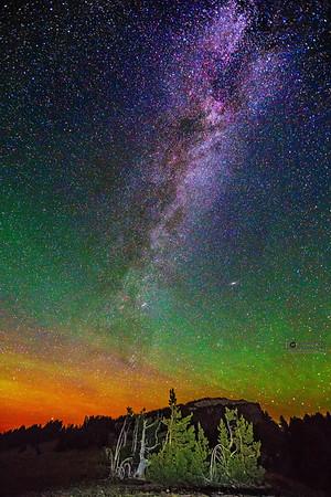 The Aurora Borealis, Andromeda Galaxy and Milky Way over Llao Rock, Crater Lake National Park