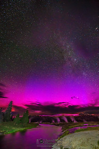 """""""Sky Dance,"""" The Aurora Borealis and  Andromeda Galaxy over the Firehole River and Midway Geyser Basin, Yellowstone National Park"""