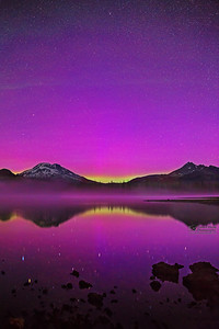 """Pink Glass,"" The Aurora Borealis and the stars in the night sky over Sparks Lake, the South Sister and Broken Top, Deschutes National Forest"