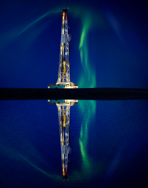 Drilling Rig and Lake Reflection