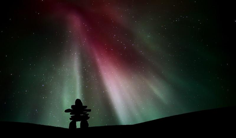 Northern light above an inukchuk in scenic Saskatchewan Canada