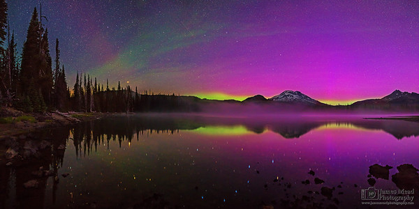 """The Magic of Midnight,"" The Aurora Borealis and the stars in the night sky over Sparks Lake, the South Sister and Broken Top, Deschutes National Forest"