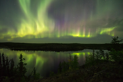 Aurora curtains with lake reflections, Ingraham trail Canada