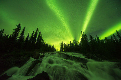 Green aurora through the clouds, Cameron River Ramparts Canada