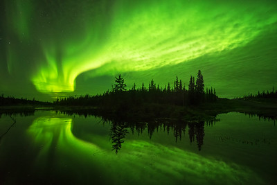 Intense aurora activity through the clouds, Ingraham trail Canada