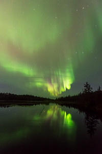 Aurora through the clouds, Ingraham trail Canada