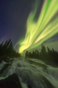 Northern lights over Cameron river rampart falls, Canada