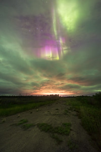 Purple northern lights through the cloud break, Northwest Territories Canada