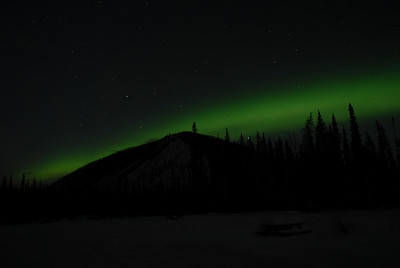The Aurora kept flirting with this hill, moving above it and then behind it.