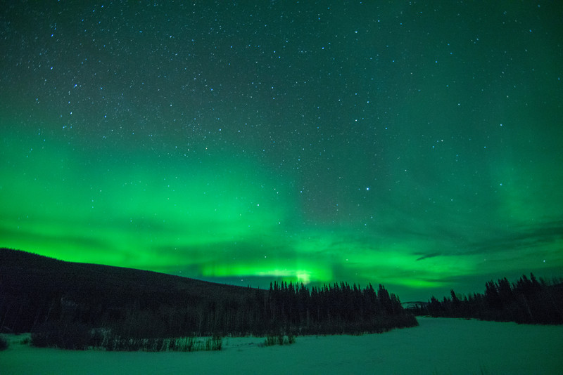 The aurora borealis light up the sky over the Chatanika River, north of Fairbanks, Alaska.